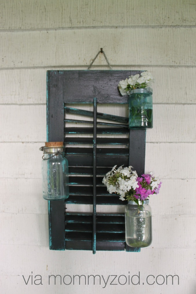 Repurpose an old shutter with mason jars to create a flower wall via www.mommyzoid.com